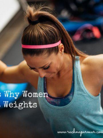 women lift weights