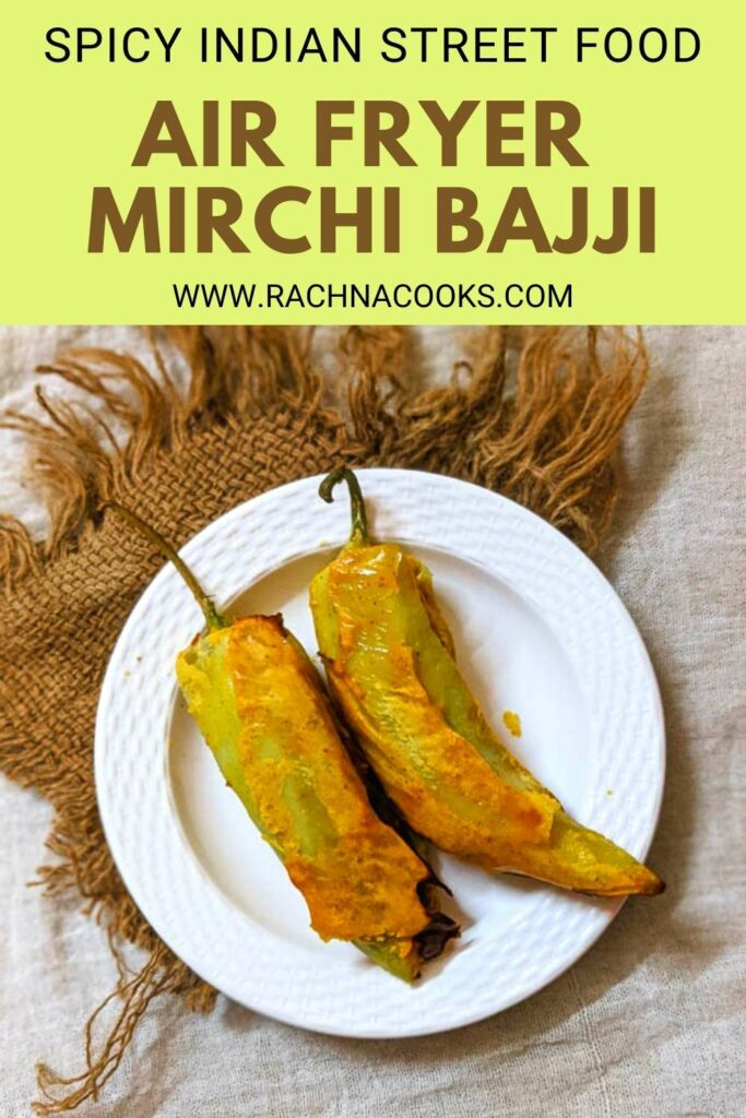 2 Golden mirchi bajjis on a white plate with a brown mat in the background.