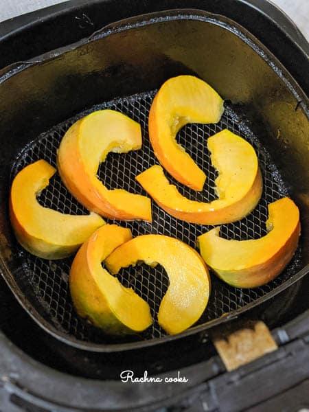 Pumpkin wedges in an Air fryer basket