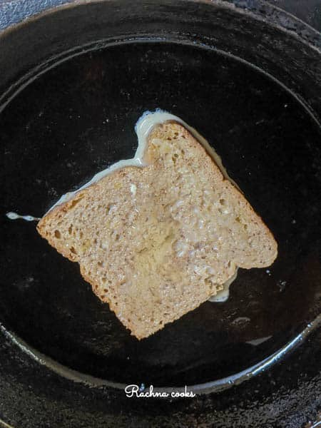 a slice of french toast cooking in a skillet