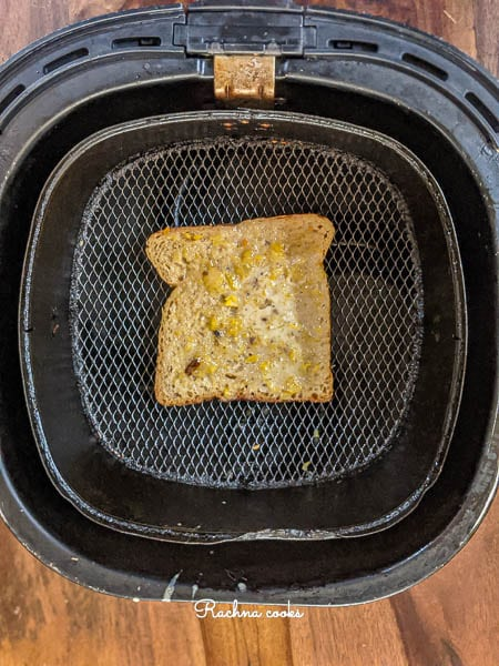 A slice of dipped bread in the Air fryer basket.