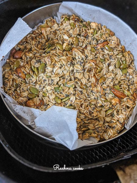 Toasted granola in air fryer basket after air frying