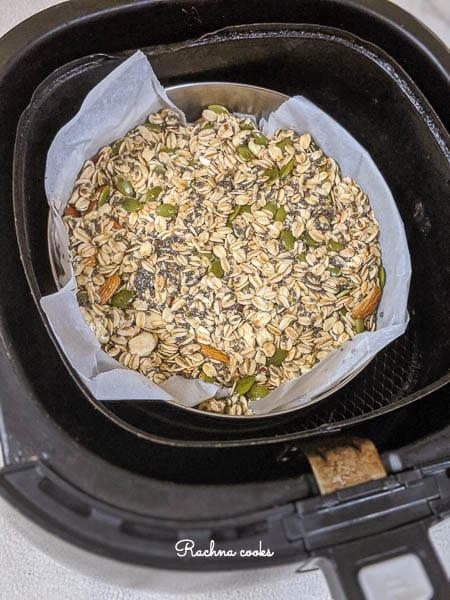 granola in air fryer basket for air frying