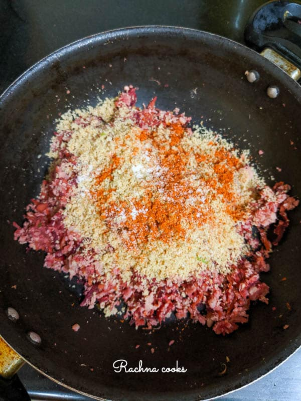 Add bread crumbs with spices and mix together.