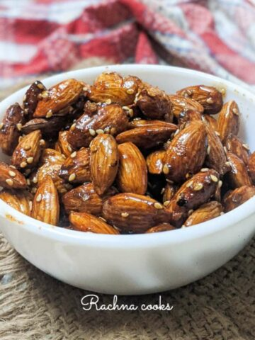 honey roasted almonds in a white bowl