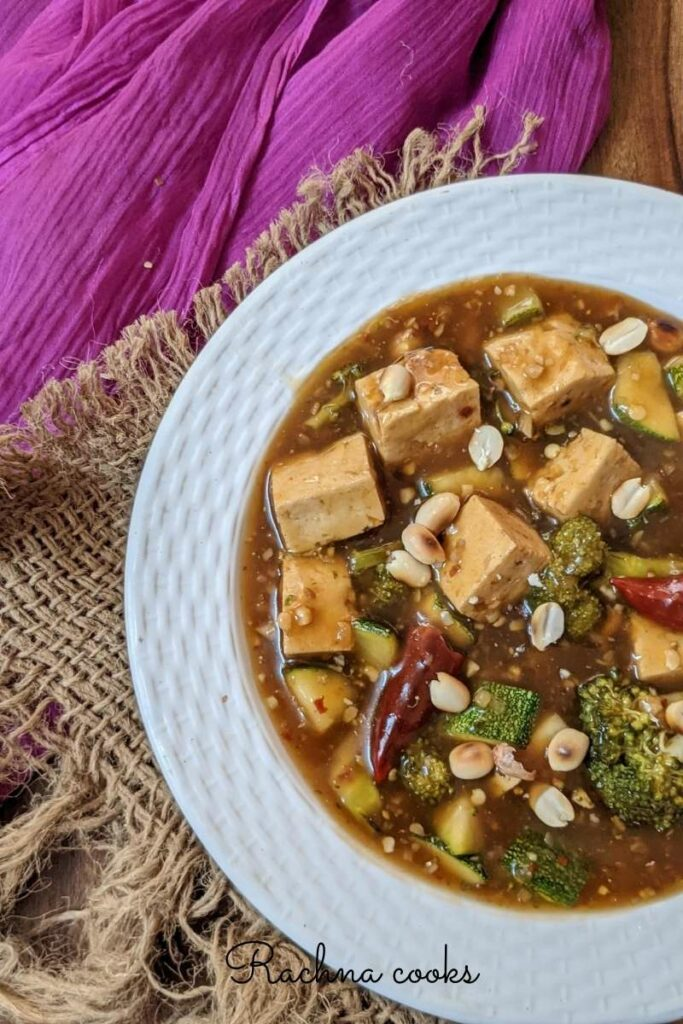 Delicious kung pao tofu curry on a white plate