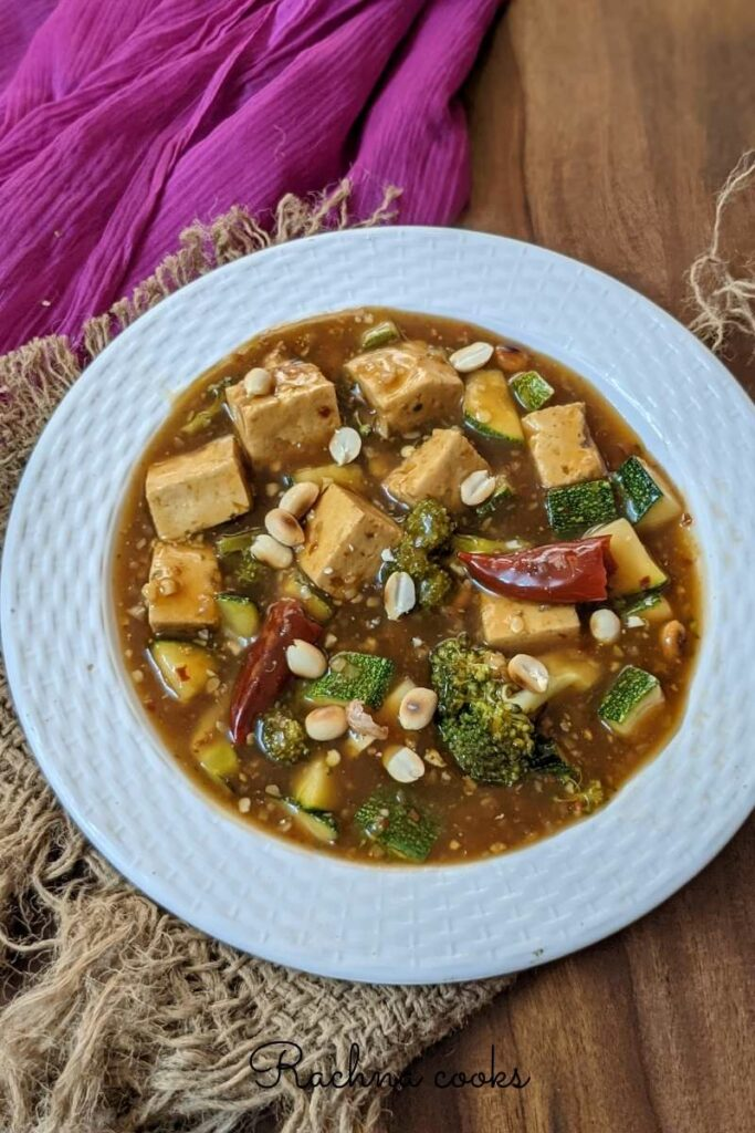 kung pao tofu curry in a white plate