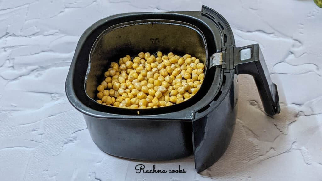 chickpeas in air fryer after 6 minutes of air frying