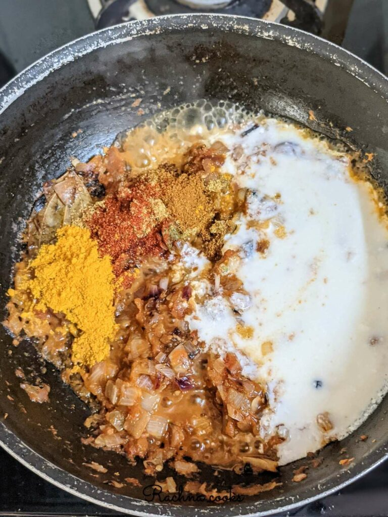 Fried onion, ginger garlic and tomatoes with yogurt and spices in a pan