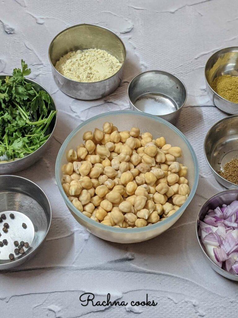Ingredients to make falafels arranged in bowls
