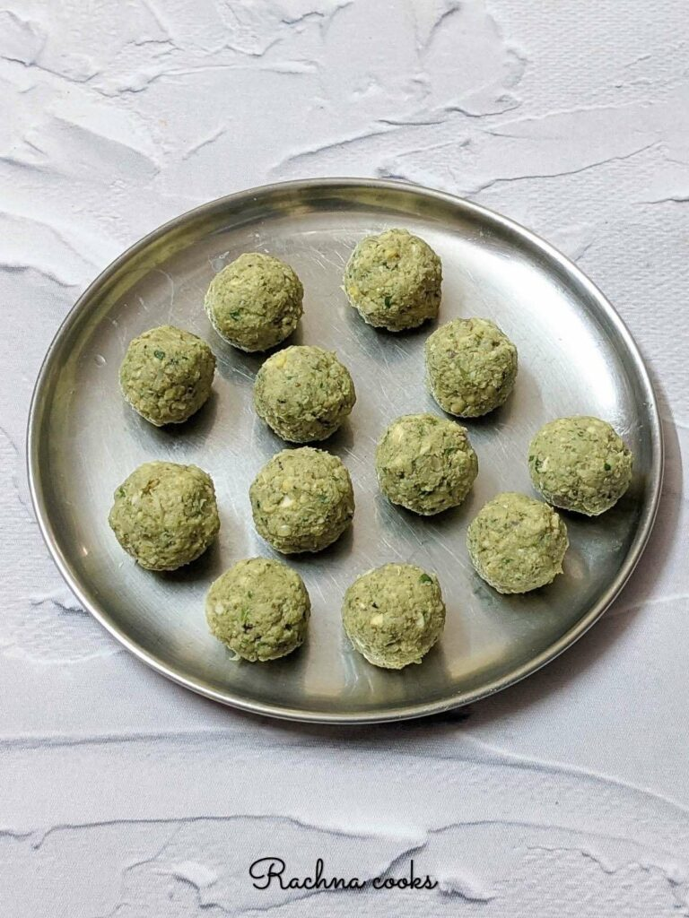 Falafel  balls ready for air frying on a plate