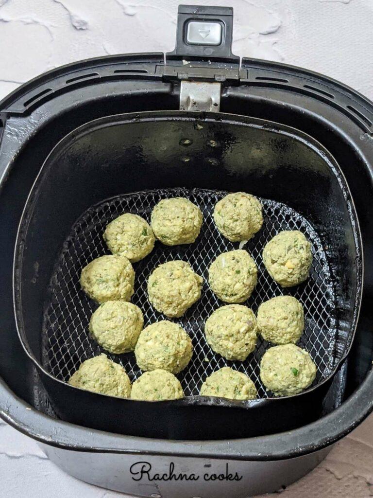 15 falafel balls in an air fryer basket for air frying