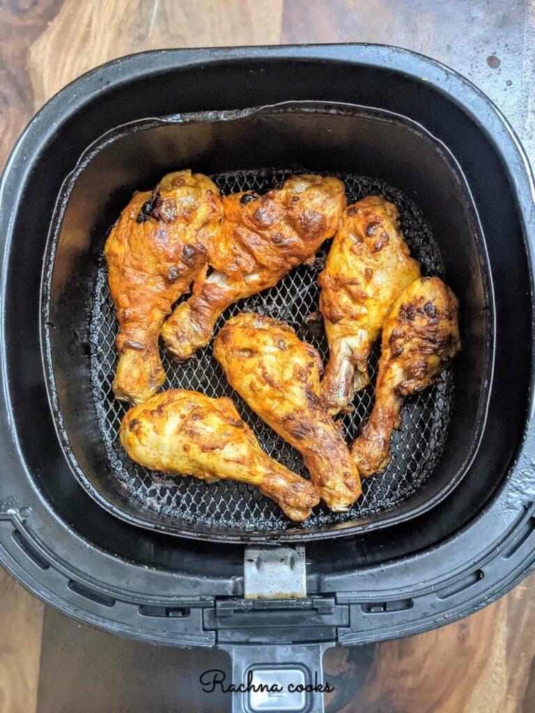 tandoori chicken drumsticks done in the air fryer basket, ready to serve.
