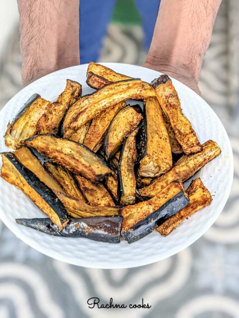 air fried eggplant fries on a white plate
