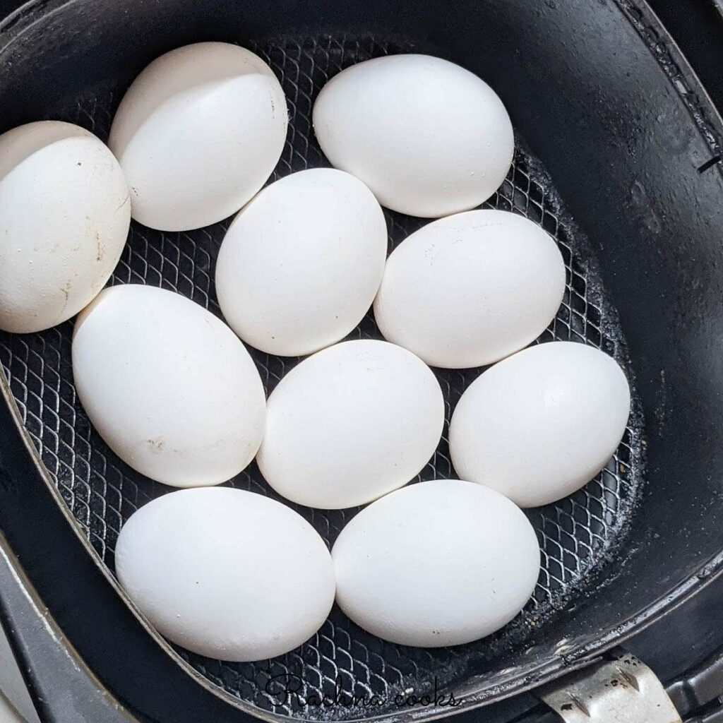 Eggs after air frying in the air fryer basket.