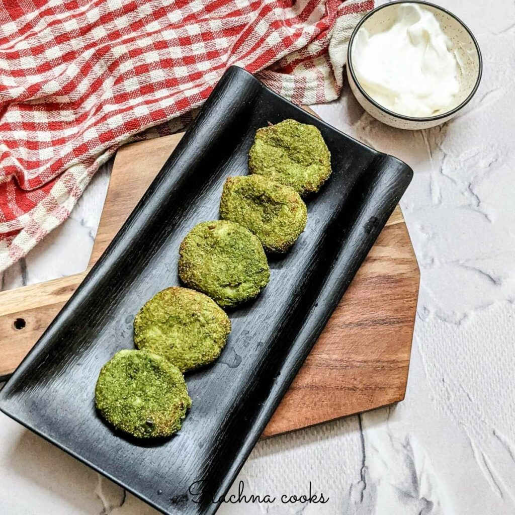 tasty hara bhara kebab on a black platter with mayo