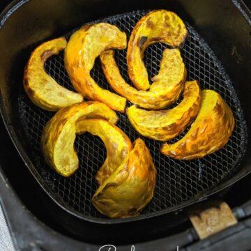 Roasted pumpkin wedges in air fryer basket