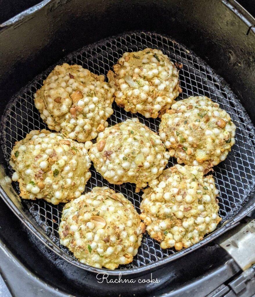 air fried sabudana vada in air fryer basket.