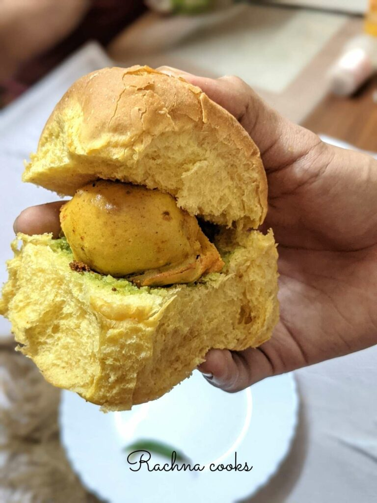 Close up of vada pav held in hand