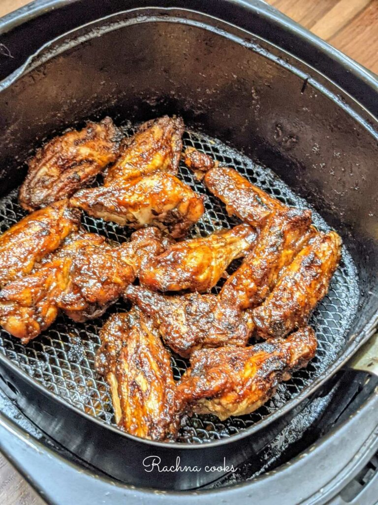frozen bbq chicken wings air fried in the air fryer basket.
