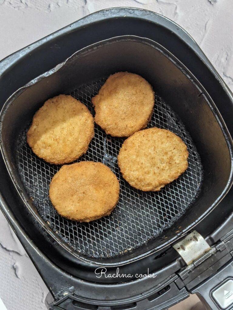 Brown crispy chicken patties cooked from frozen in air fryer basket
