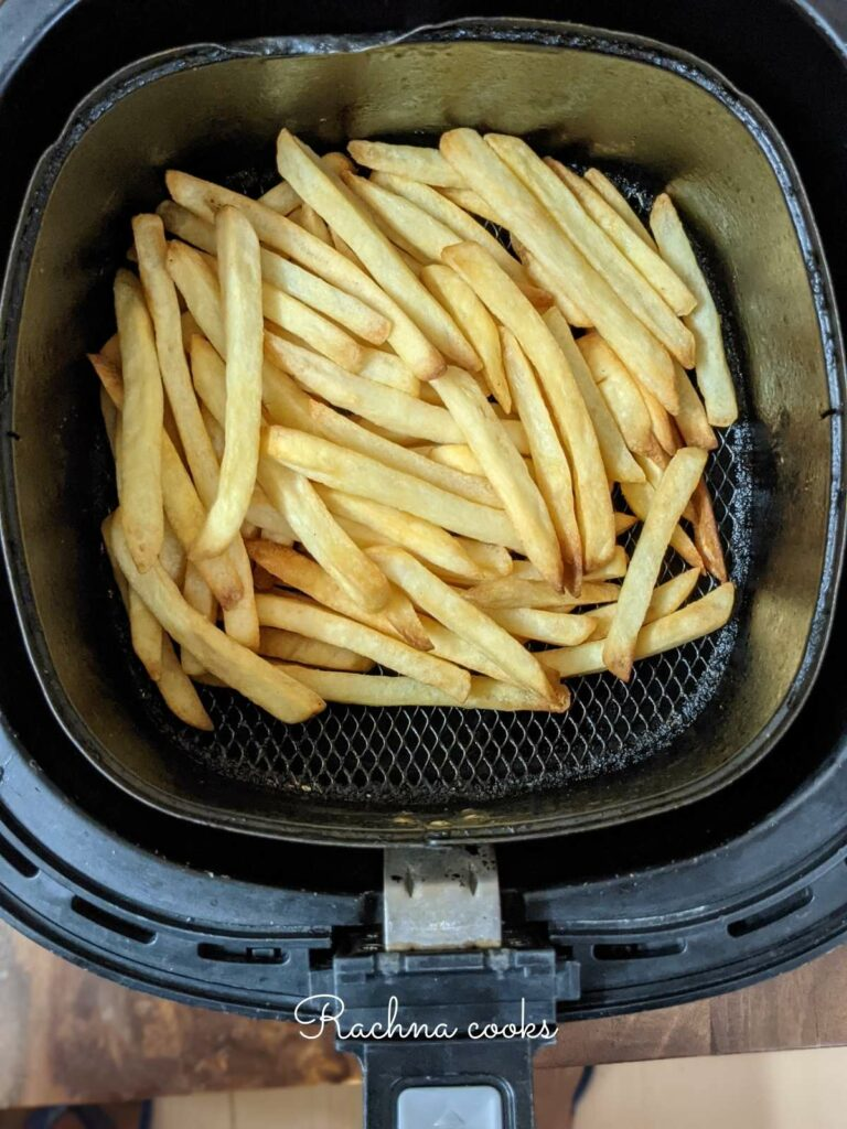 Crispy french fries done in air fryer from frozen in the air fryer basket.