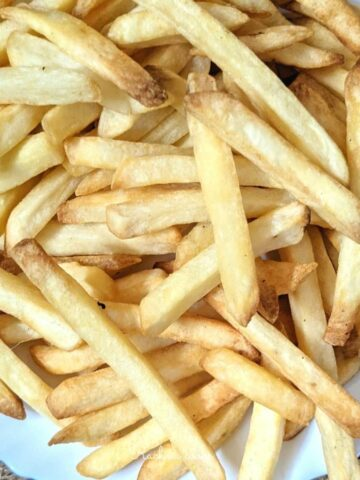 close up of frozen french fries done in air fryer