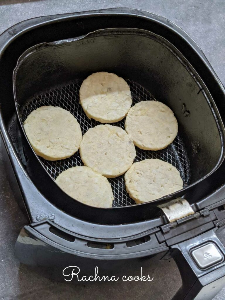 frozen hash brown patties for air frying placed in the basket.