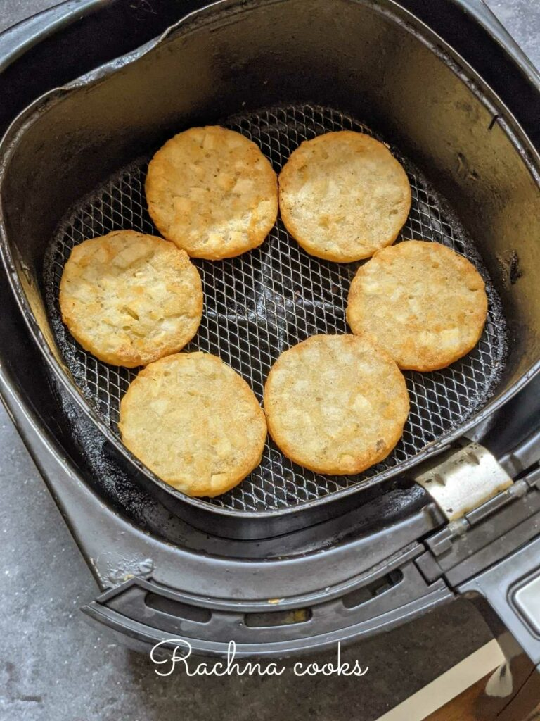 air fryer hash brown patties in air fryer basket.