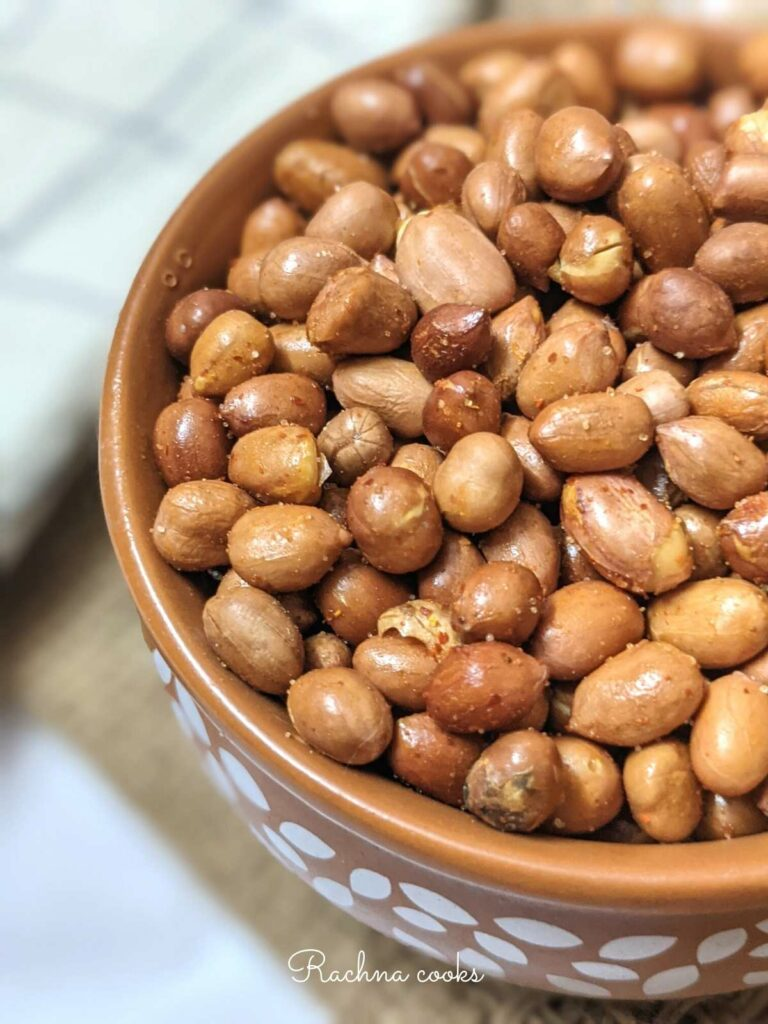 Close up of a bowl of spicy air fried roasted peanuts.