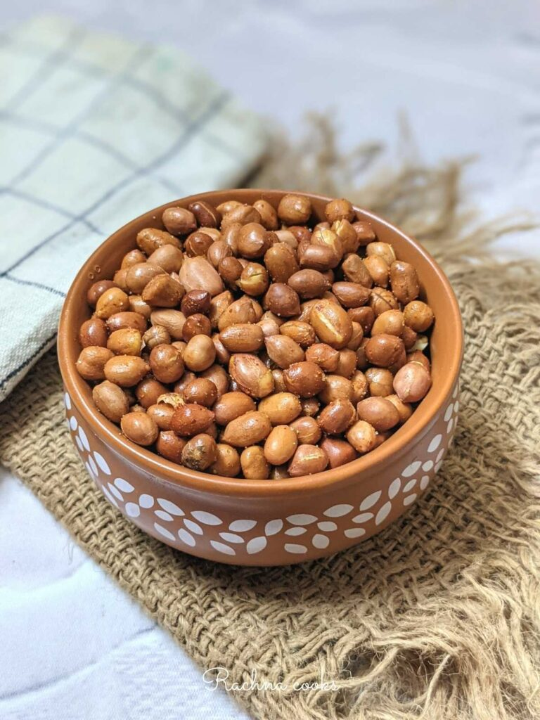 A bowl of roasted peanuts done in air fryer with a spicy coating.