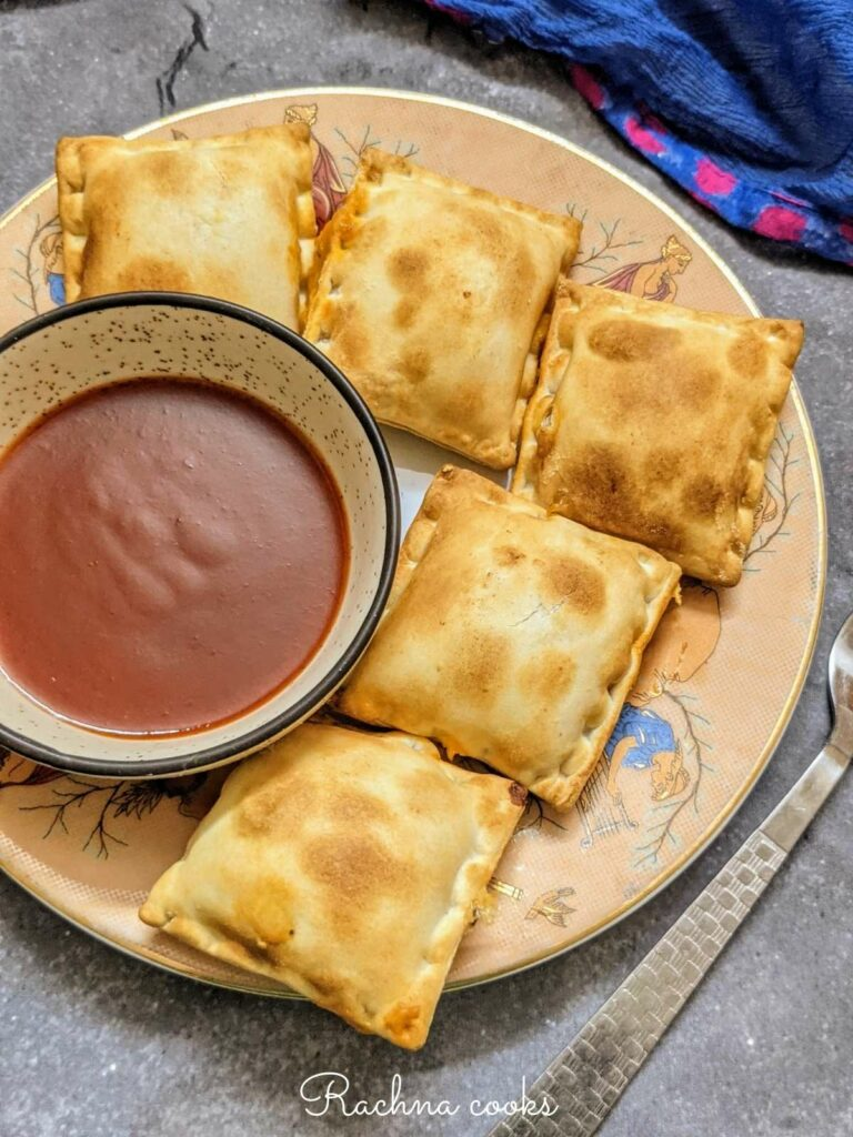 air fried frozen pizza rolls on a plate with a bowl of ketchup.