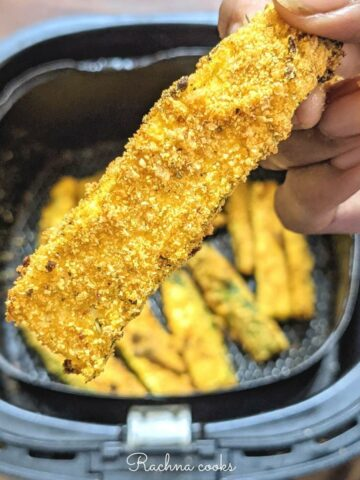 Close of air fried zucchini fry
