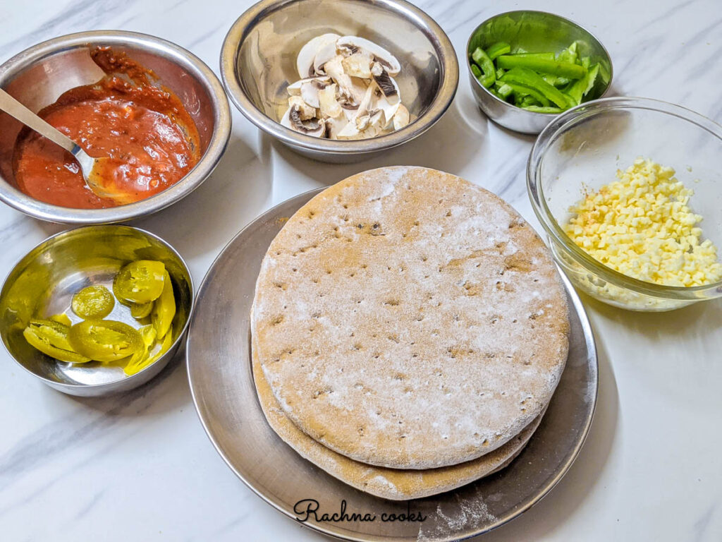 Ingredients laid out to make homemade pizza