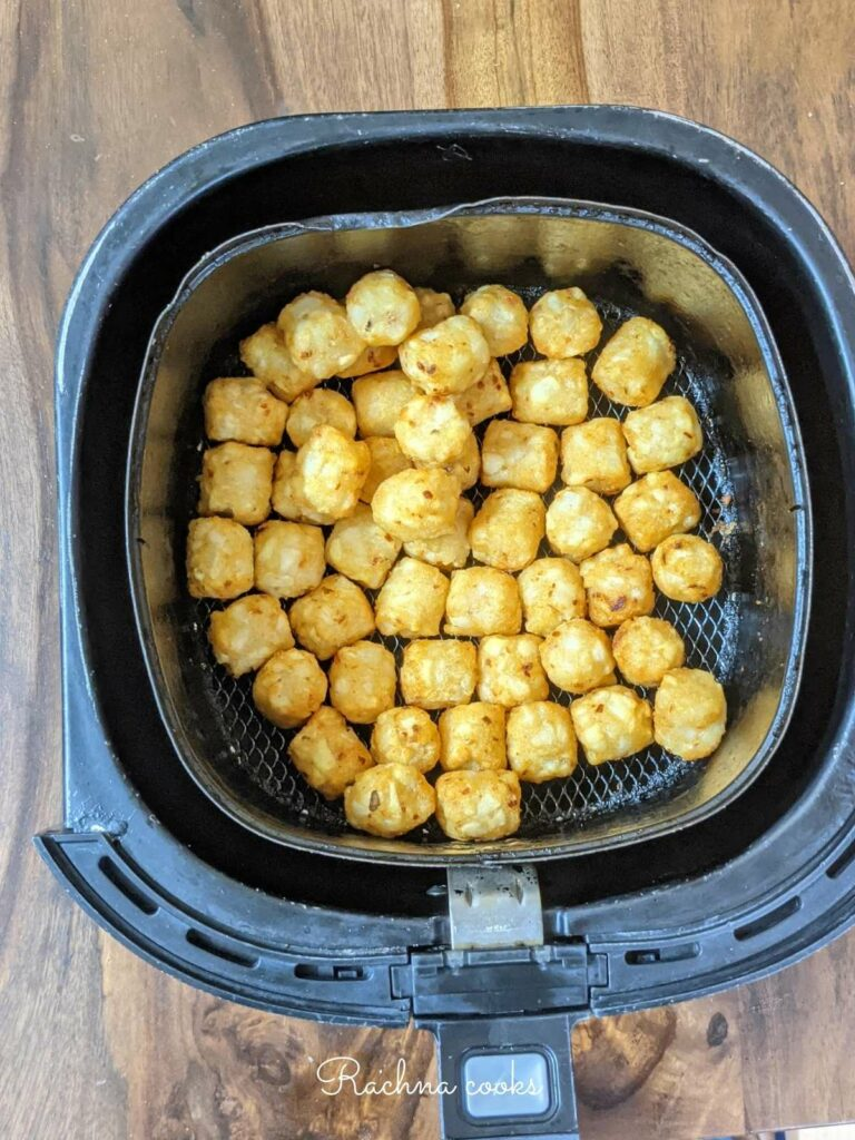 Golden tater tots after air frying.