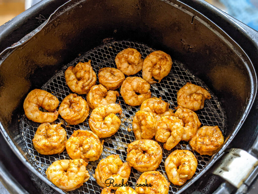 Delicious Cajun shrimp ready for eating after air frying shown here in the basket.
