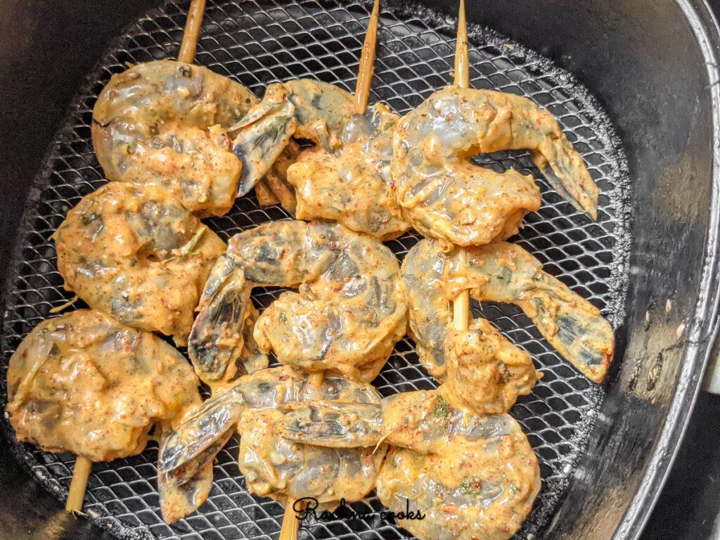 Tandoori shrimp skewered put in air fryer for cooking