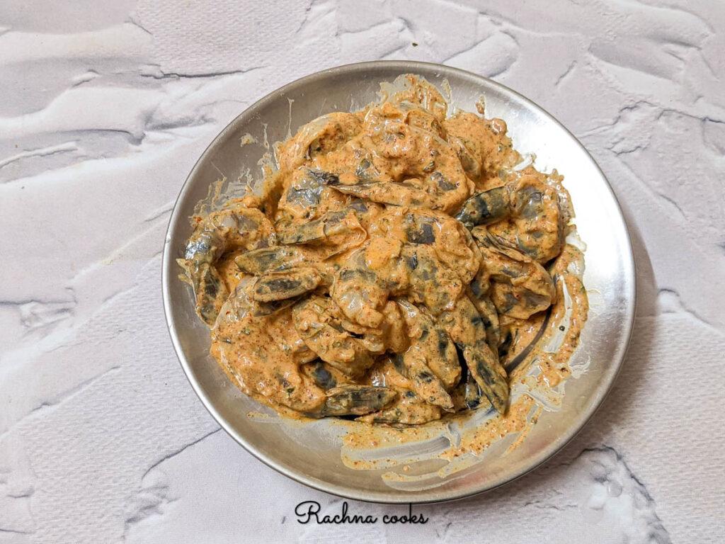 Shrimp marinated in tandoori marinade kept for 30 minutes to 1 hour.