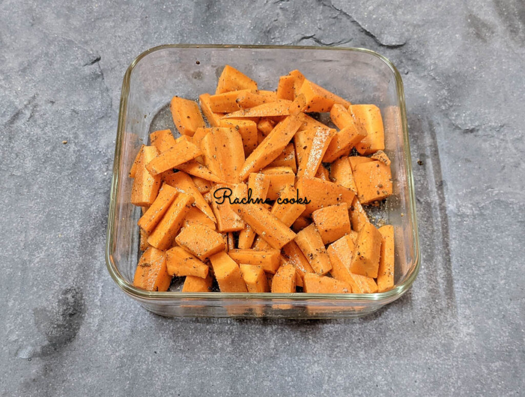 cut carrots marinated in spices and oil.