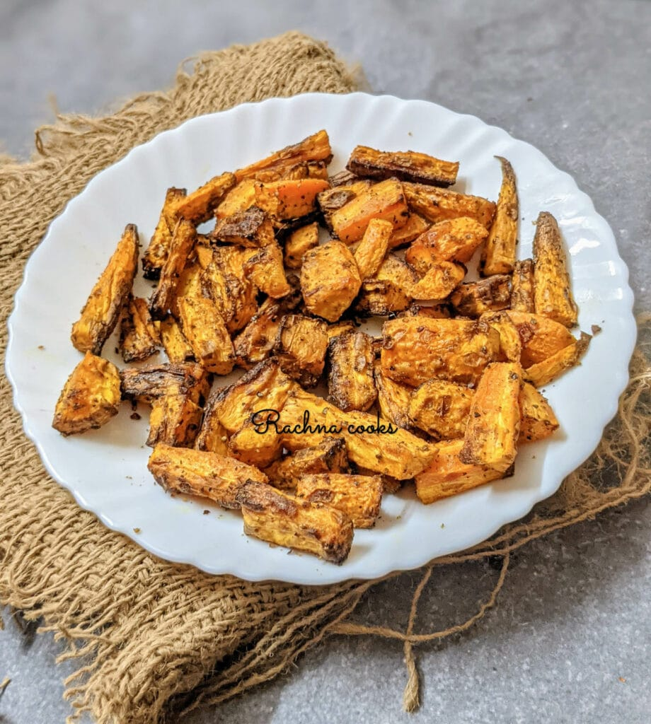 roasted carrots in air fryer on a white plate.