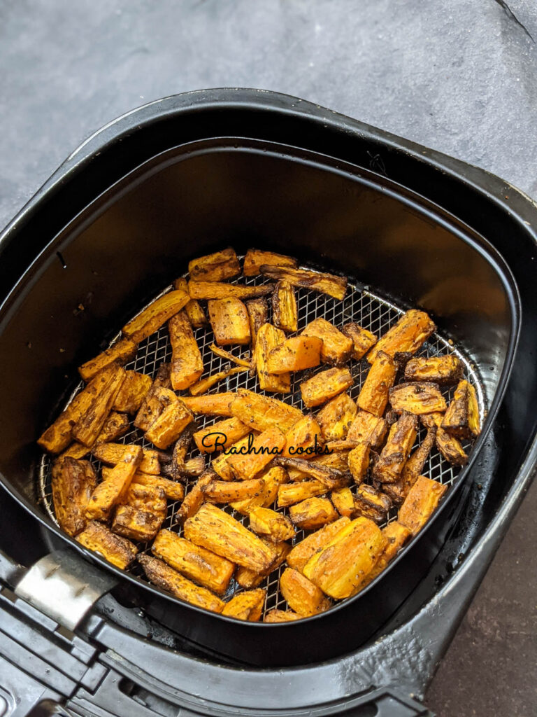 carrots after air frying in the air fryer basket.