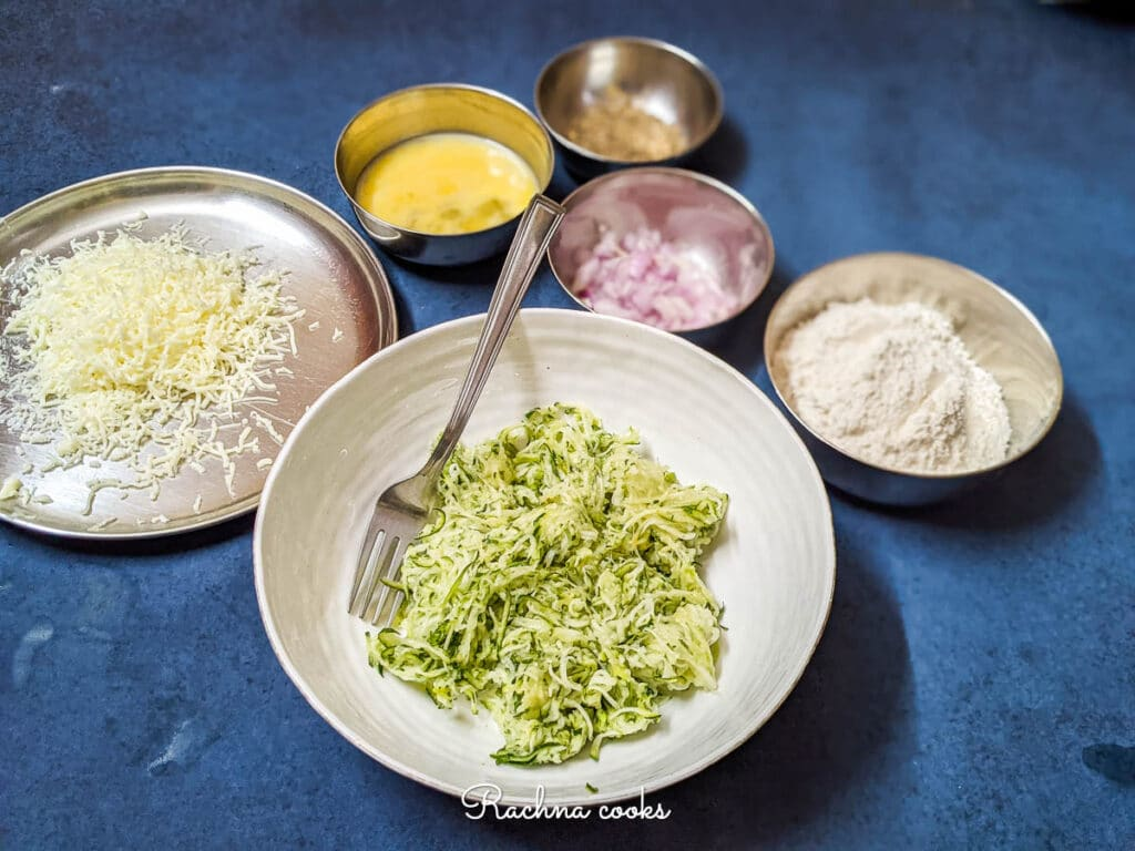 ingredients for making zucchini fritters in bowls