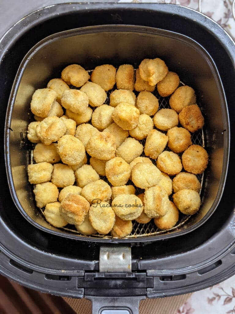 golden air fried popcorn chicken ready in the basket