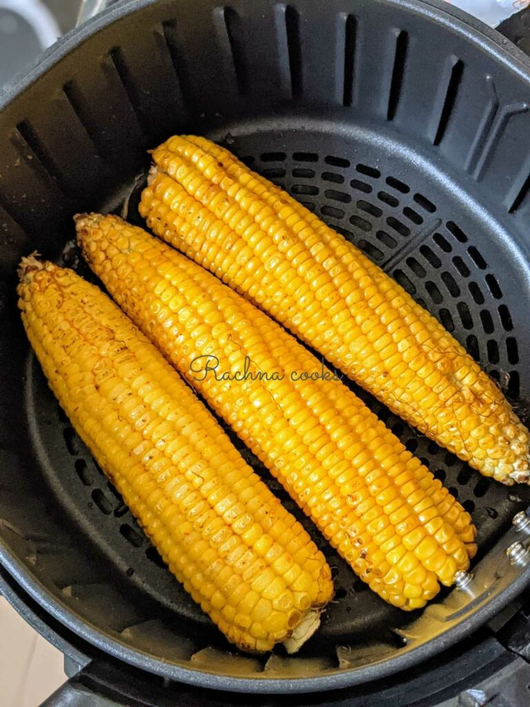3 corn on the cob in air fryer basket already air fried.