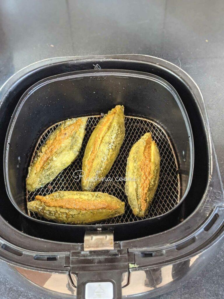 karelas in air fryer basket ready for air frying.