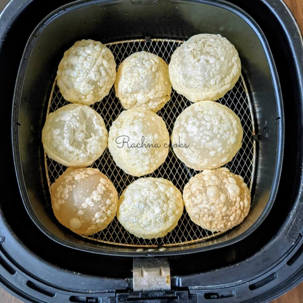 puffed puris in air fryer after air frying.