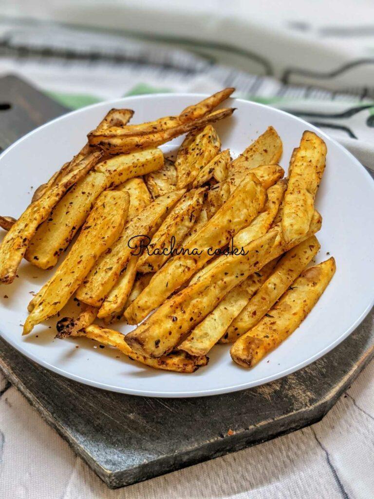 Crispy air fryer sweet potato fries on a white plate.