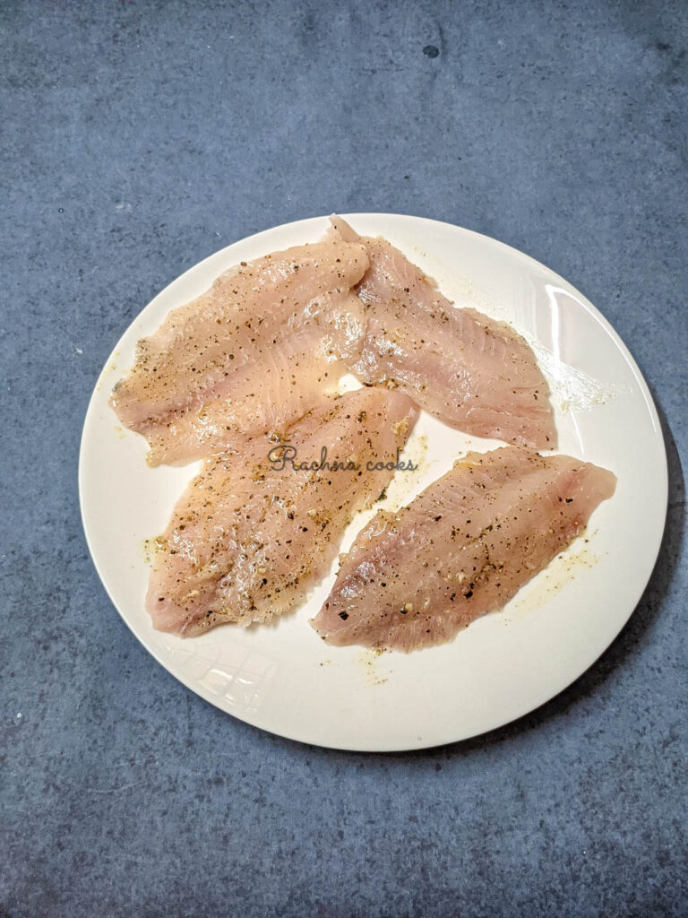 Tilapia fillets brushed with spice mix