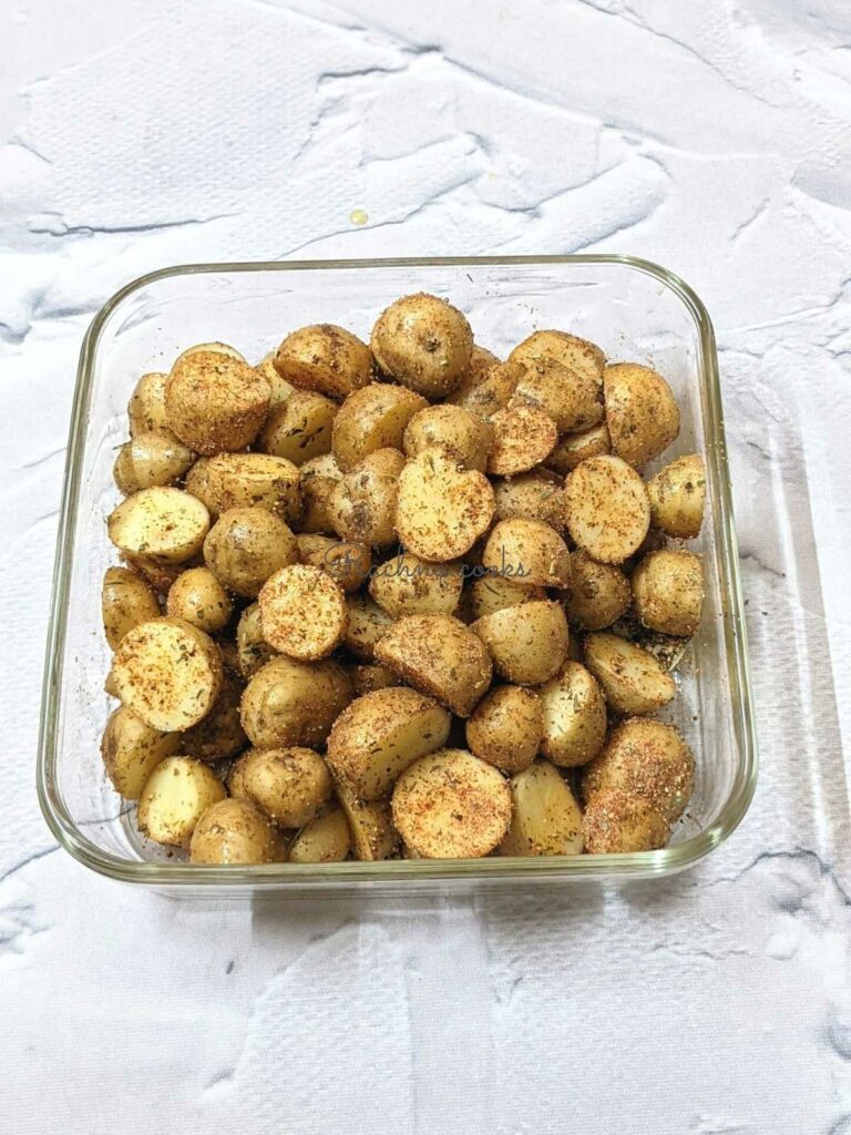 Baby potato halves coated with spices.